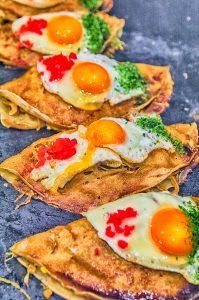 56380549 - okonomiyaki japanese pizza hiroshima style